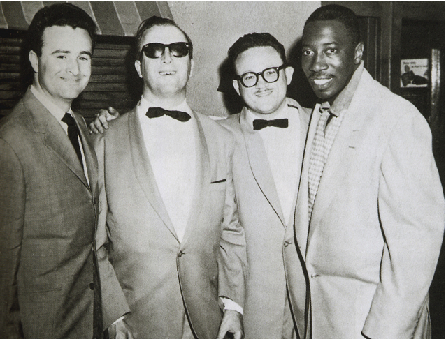 From left to right: Bobbejaan Schoepen (Toots was his band member in 1951), George Shearing (the legendary blind jazz-pianist he worked with), Toots Thielemans himself, and Count Basie's blues-singer Joe Williams.  (New York, 1953)